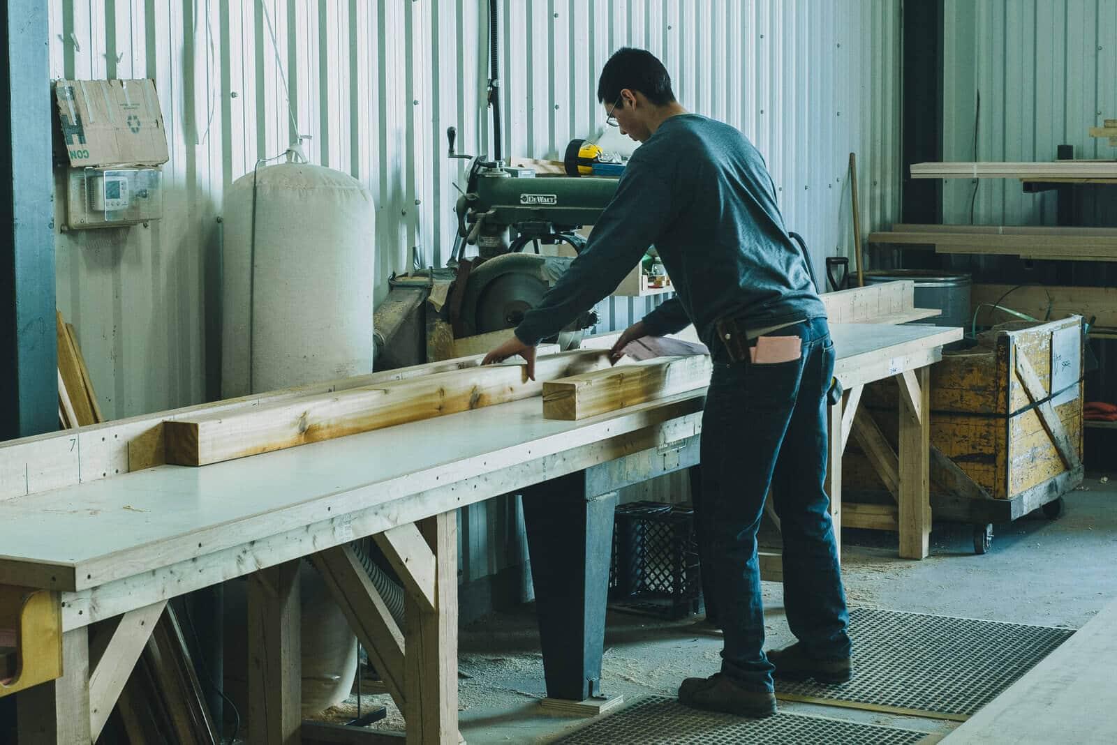 Staff cutting some wood.